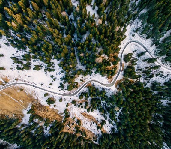 aerial-view-of-snowy-forest-with-a-road-captured-f-PAUZRF7.jpg